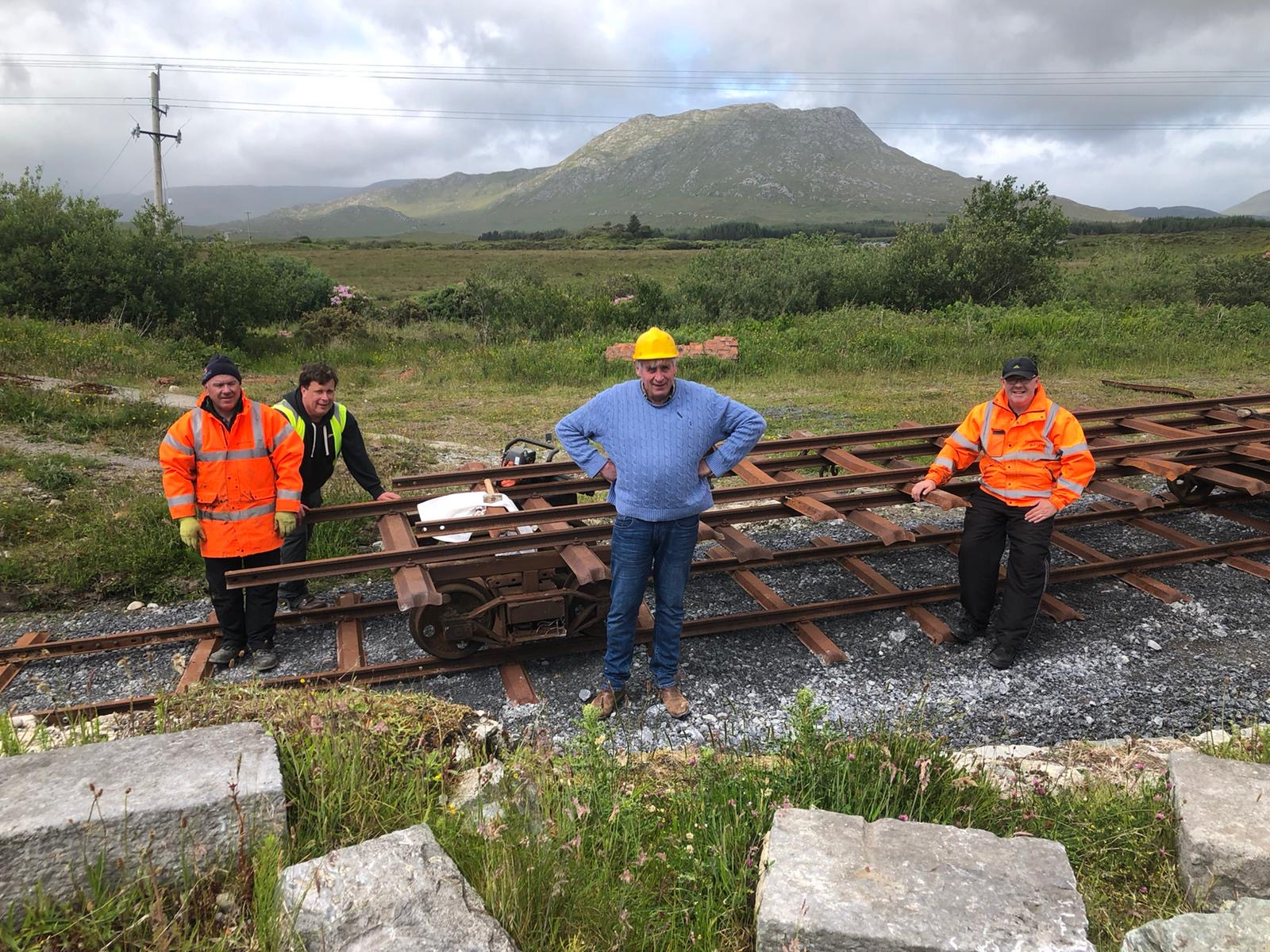 Happy volunteers moving rail panels to the railhead – very satisfying work!