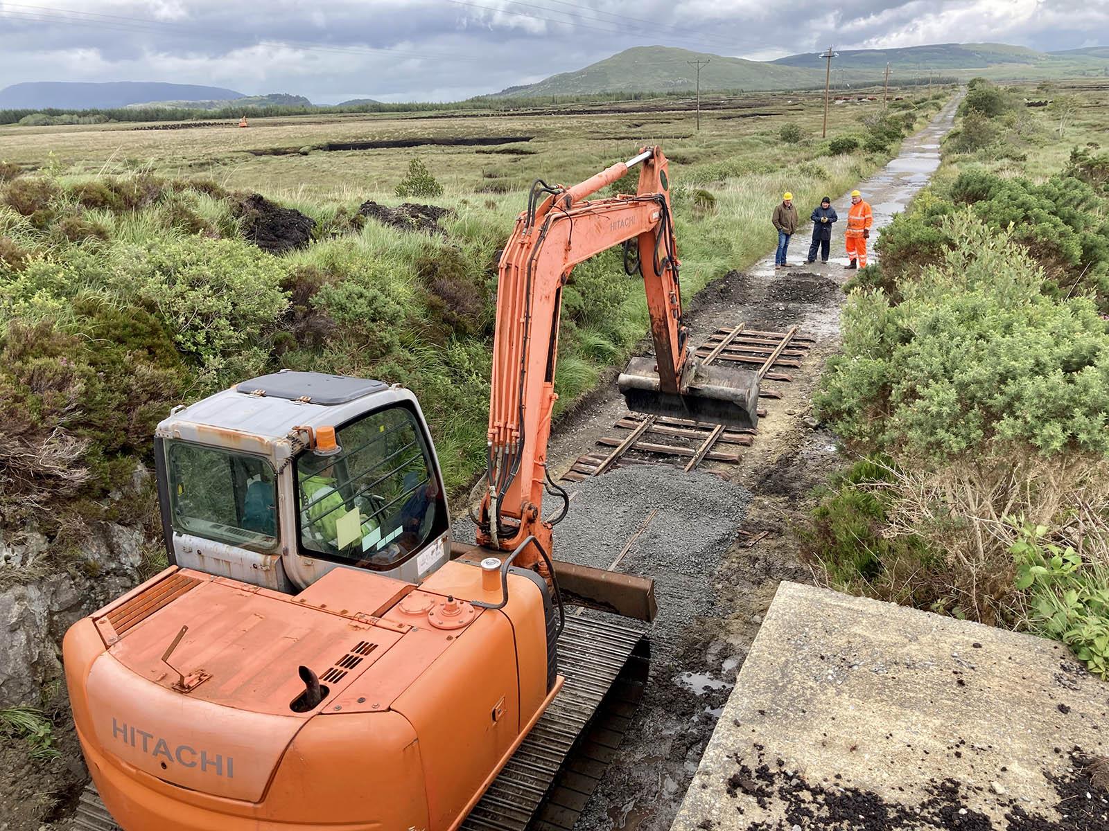 The excavator spreads some fine ballast