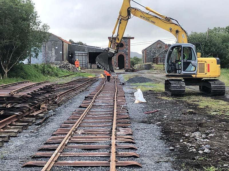 Laying track in the yard at the western ( Clifden) end of the site.
