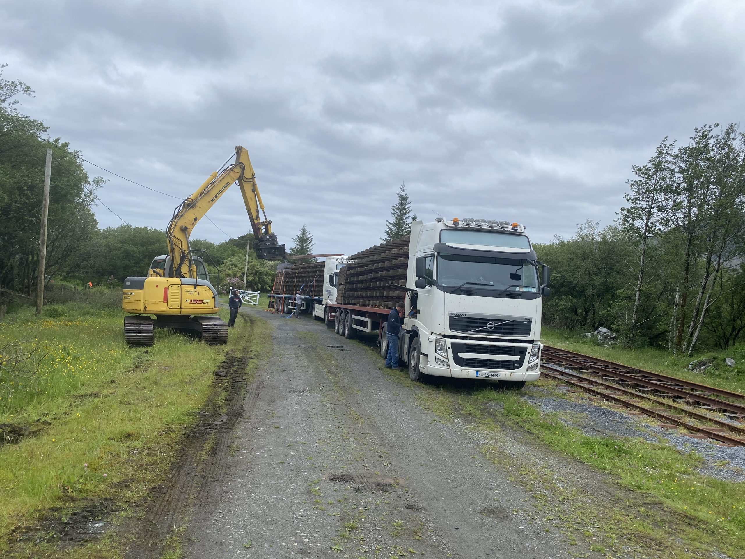 """Unloading two truck loads of 5'3"""" track materials at Maam Cross June 5th."""